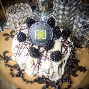 voodoo king cake Filled with Blackberry and Creole Cream Cheese, Drizzled with White and Dark Chocolate
