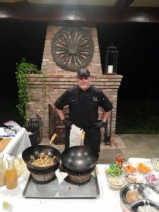 Chef Wells at Pad Thai action station Wedding Catering in Baton Rouge