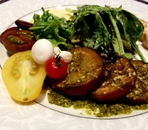 Grilled eggplant with baby greens, heirloom garden tomatoes, mozzarella pearls and basil dijon vinaigrette